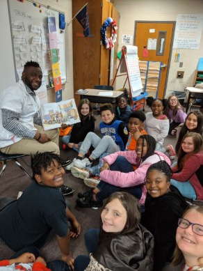 Dr. Hodges reading to students